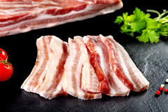 Fresh and raw meat. Still life of bacon Barbacue steaks. Royalty Free Stock Photo