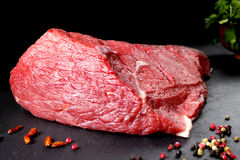 Fresh and raw meat. Still life of red meat steak ready to cook on the barbecue Royalty Free Stock Images