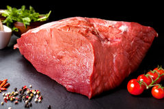 Fresh and raw meat. Still life of red meat steak ready to cook on the barbecue. Black slate background Stock Image
