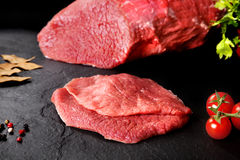 Fresh and raw meat. Still life of steaks ready for cooking, barbecue. Royalty Free Stock Images