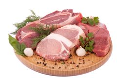 Fresh raw meat. Fresh tasty raw meat on white surface Royalty Free Stock Photos