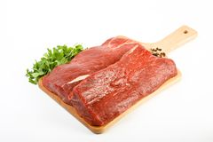 Fresh raw meat. Fresh tasty raw meat on white surface Royalty Free Stock Image