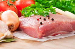 Fresh raw meat tenderloin with vegetables. Closeup. Food background Stock Images