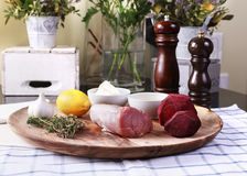 Fresh raw meat with thyme. Lemon garlic Stock Photography