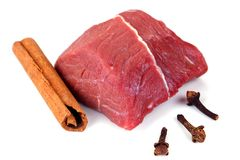 Fresh Raw Meat. Fresh uncooked cow meat with cloves and cinnamon, ready for barbecue and sate Stock Photography