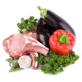 Fresh raw meat and vegetables. Isolated on white background Royalty Free Stock Image