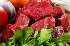 Fresh raw beef. Fresh raw meat and vegetables Royalty Free Stock Images