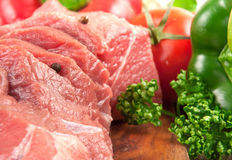 Fresh raw meat with vegetables. On the cutting board closeup. Soft focus Stock Photography