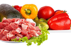Fresh raw meat and vegetables isolated. On white Stock Images