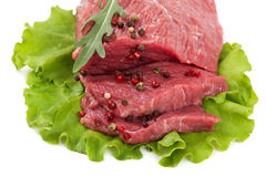 Fresh raw meat on a white background. Fresh raw meat isolated on a white background Stock Photo