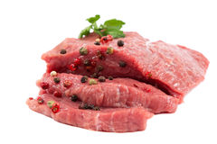 Fresh raw meat on a white background. Fresh raw meat isolated on a white background Royalty Free Stock Image