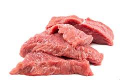 Fresh raw meat on a white background. Fresh raw meat isolated on a white background Stock Photos