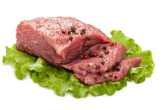 Fresh raw meat on a white background. Fresh raw meat isolated on a white background Stock Photos