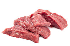 Fresh raw meat on a white background. Fresh raw meat isolated on a white background Royalty Free Stock Image