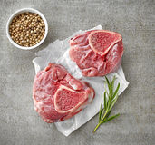 Fresh raw meat on white wrapping paper. Top view Royalty Free Stock Photography