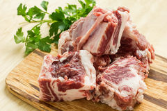 Fresh raw meat on wooden background. Fresh raw meat on wooden board on white table with parsley. Selective focus Royalty Free Stock Images