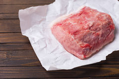 Fresh raw meat on wooden background. Fresh raw meat on paper on dark table. Selective focus Stock Photography