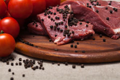 Fresh raw meat. On wooden board Stock Image