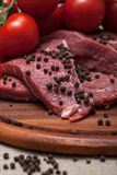 Fresh raw meat. On wooden board Stock Photography