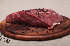 Fresh raw meat. On wooden board Royalty Free Stock Image