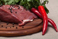 Fresh raw meat. On wooden board Royalty Free Stock Photography