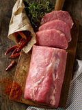 Fresh raw meat on wooden cutting board Royalty Free Stock Images