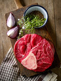 Fresh raw meat on wooden cutting board Royalty Free Stock Photo