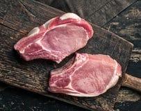 Fresh raw meat on wooden cutting board. Fresh raw meat on old wooden cutting board Stock Image