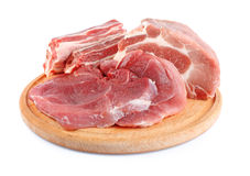 Fresh raw meat on wooden plate Stock Images