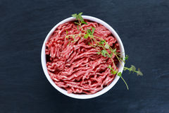 Fresh raw mince beef on old blue stone background.  Royalty Free Stock Images