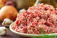 Raw minced beef in a bowl. Fresh raw minced beef in a bowl Stock Photos