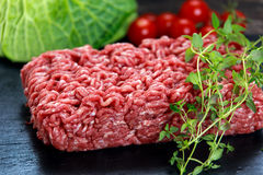 Fresh raw minced beef on old blue stone.  Stock Photography