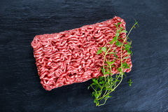 Fresh raw minced beef on old blue stone background. Fresh raw minced beef on old blue stone background Stock Image