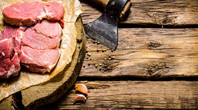 Fresh raw minced meat with an axe. On a wooden table. Free space for text Royalty Free Stock Photo