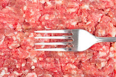 Fresh raw minced meat with fork Royalty Free Stock Images