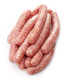 Fresh raw minced meat sausages. On white background Stock Images