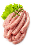 Fresh raw minced meat sausages. On white background Stock Image