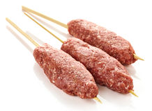 Fresh raw minced meat skewers kebabs. Isolated on white background Royalty Free Stock Photo