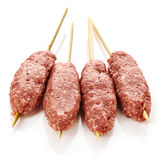 Fresh raw minced meat skewers kebabs. Isolated on white background Royalty Free Stock Image