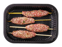 Fresh raw minced meat skewers in plastic box. Top view Stock Image