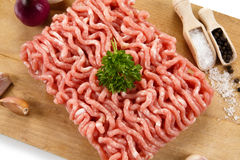 Fresh raw minced meat. Fresh raw meat on wooden desk Royalty Free Stock Photography