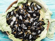Fresh raw mussels on rusty tray. Seafood concept Stock Images