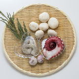 Fresh raw octopus and shrimp with mushroom and onion on bamboo t. Ray deliciously deliciously Stock Image