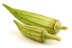 Fresh raw okra pods (Abelmoschus esculentus). On a white background Stock Images