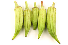 Fresh raw okra pods (Abelmoschus esculentus). On a white background Royalty Free Stock Photography