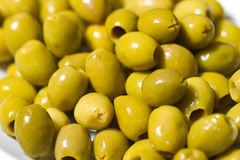 Fresh raw olives. With shiny oil Stock Photography