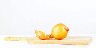 Fresh raw onion on a cutting board Royalty Free Stock Image