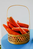 Fresh raw orange carrot. Fresh and raw orange carrot in the basket Royalty Free Stock Photography
