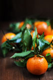 Fresh raw orange fruits on table macro close. Fresh raw orange fruits on table macro Royalty Free Stock Photography