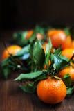 Fresh raw orange fruits on table macro close Royalty Free Stock Photography